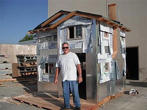 Kevin Schuder, of TWR Framing in Corona, works on a souped-up playhouse